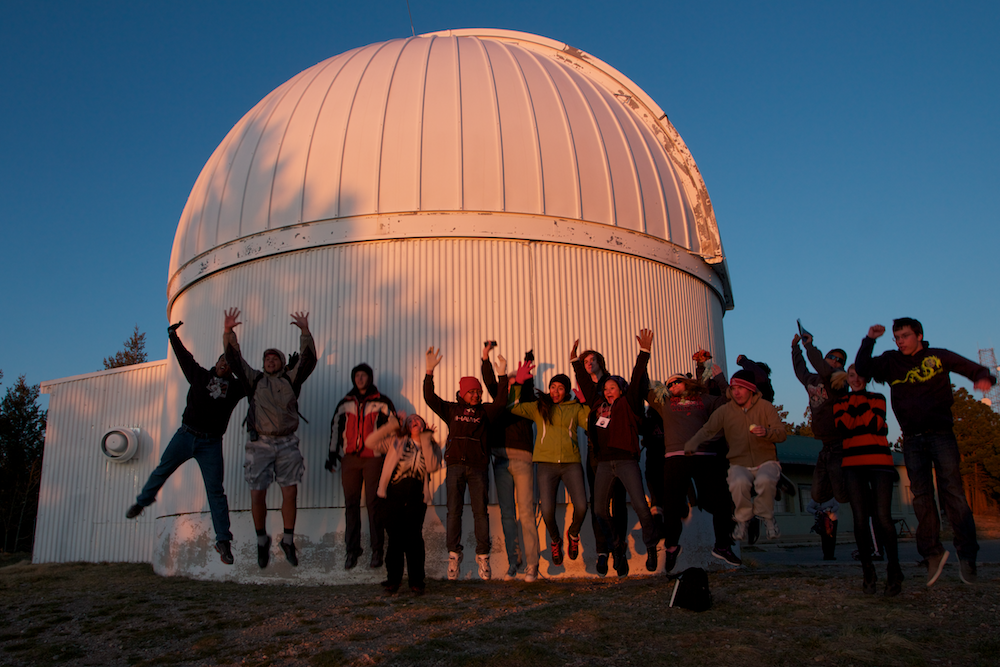 Picture of students in front of telescope facility