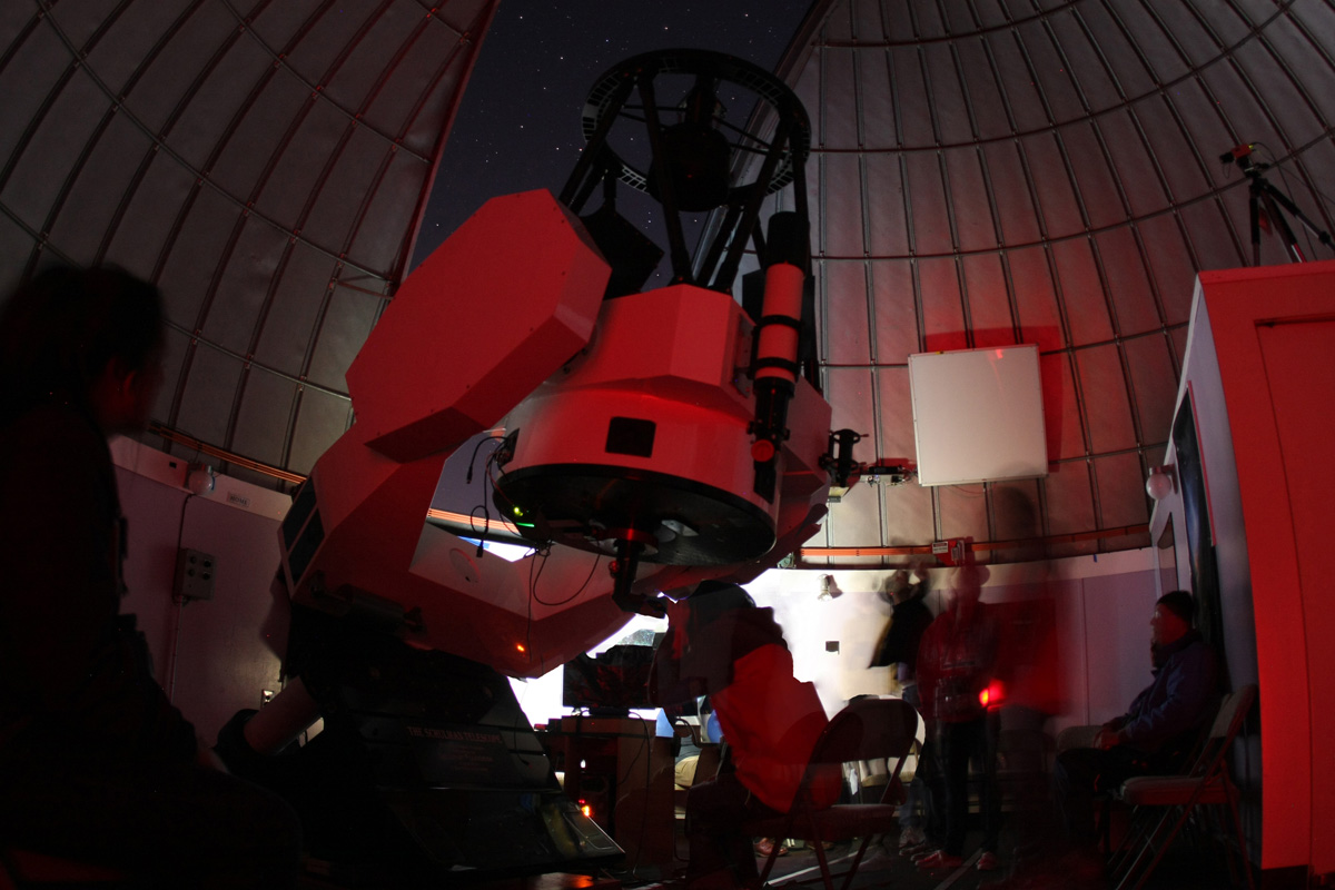 Picture of students using telescope