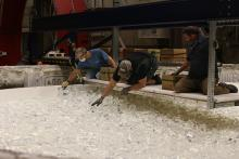 Engineers at the Richard F. Caris Mirror Lab hand-load chunks of glass into the mold