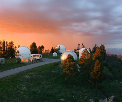 Photo of Mount Lemmon SkyCenter with sunset behind it